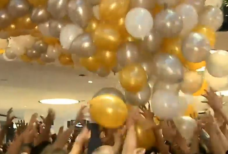 VIDEO: Five in hospital after balloon drop sparks stampede at Australian shopping centre