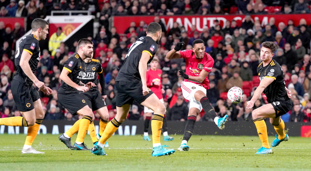 United edge Wolves to reach fourth round