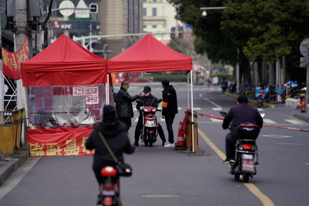 In coronavirus fight, Shanghai river town opts for caution