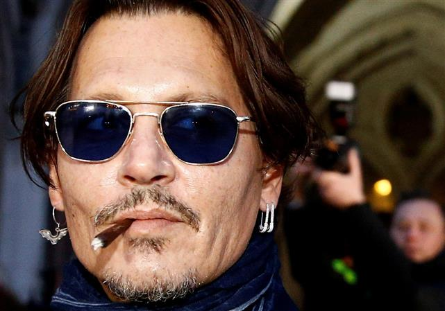Actor Johnny Depp takes Sun newspaper to court in 'wife beater' libel case