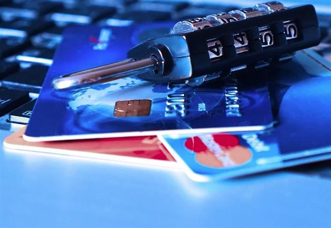 Suspect held for using stolen ATM card