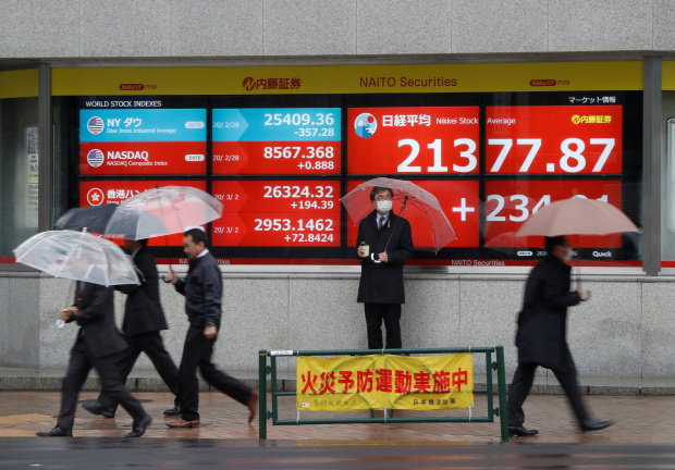 Stocks rise as central banks vow to tackle coronavirus spread