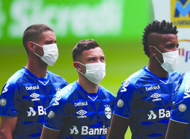 Brazil players protest by wearing masks