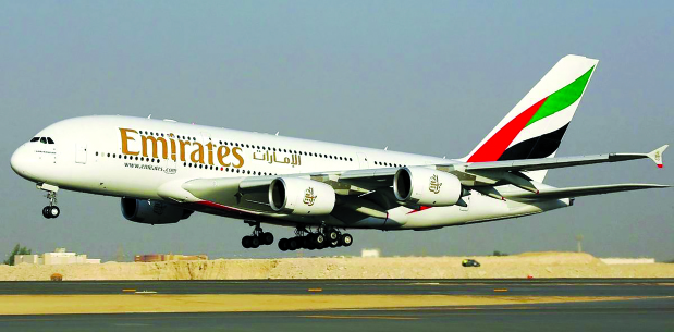 Emirates stops all passenger flights and slashes wages