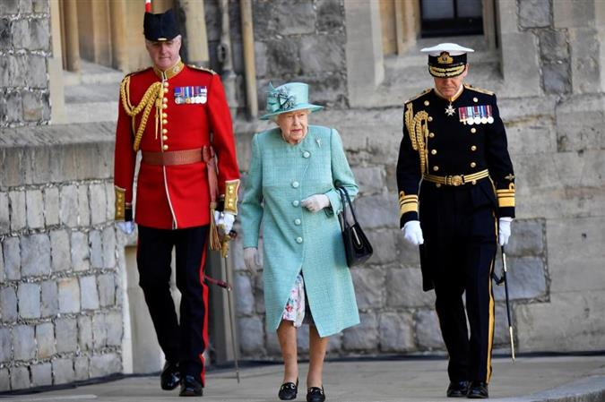 A scaled-down ceremony at Windsor marks Queen Elizabeth's official birthday