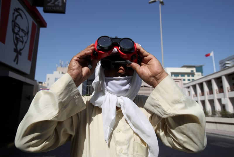"""<p><span>A man uses special protective glasses to monitor the annular solar eclipse, in Manama,</span><span data-qa-component=""""highlight-text"""" class=""""highlight"""">&nbsp;Bahrain</span><span>, June 21, 2020.</span></p>"""