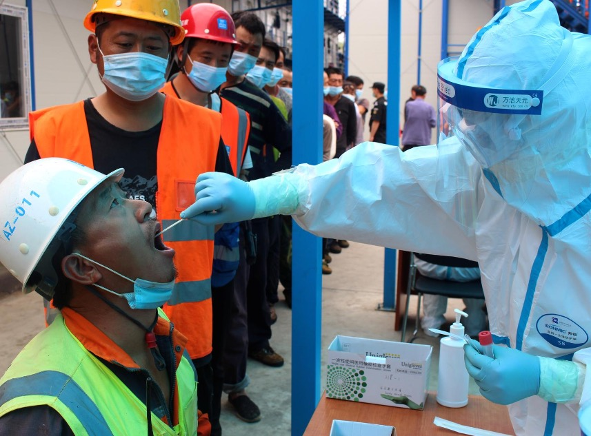 China urges coronavirus testing capacity ramp-up in preparation for potential outbreaks