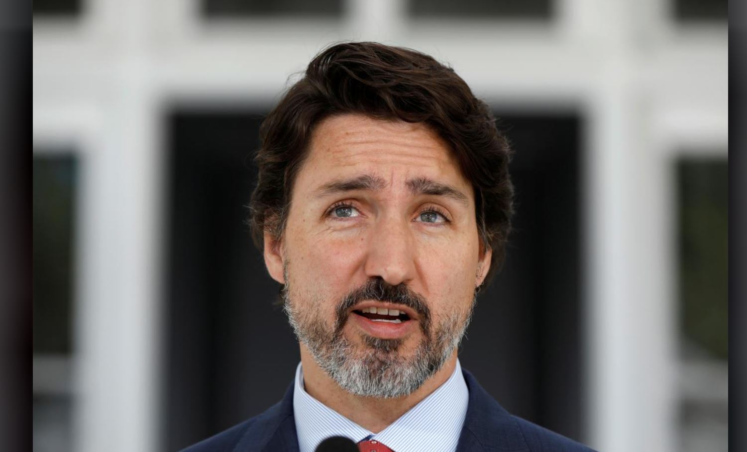 Canadian police arrest armed man near Trudeau's residence in Ottawa; Trudeau was not home