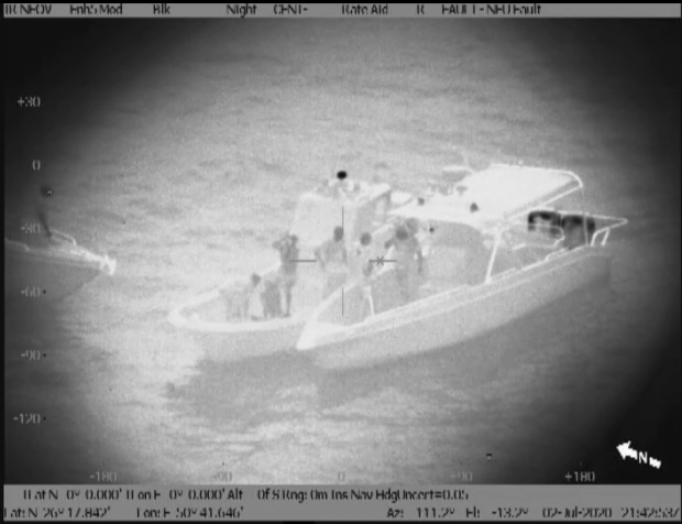 Three rescued after boat capsizes