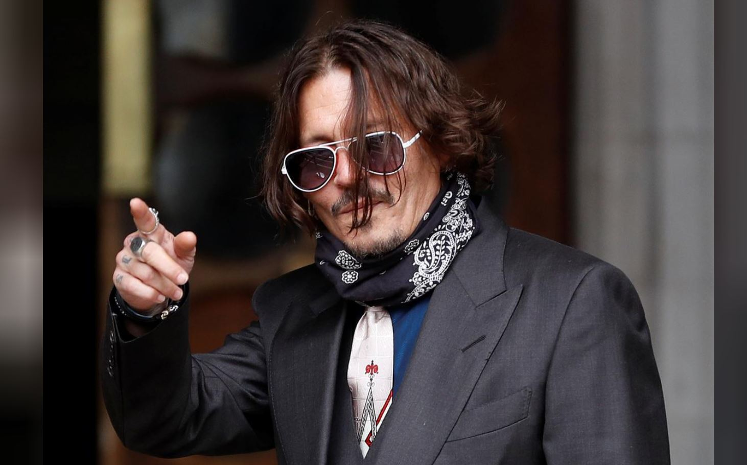 Actor Depp denies slapping ex-wife in row over 'Wino forever' tattoo