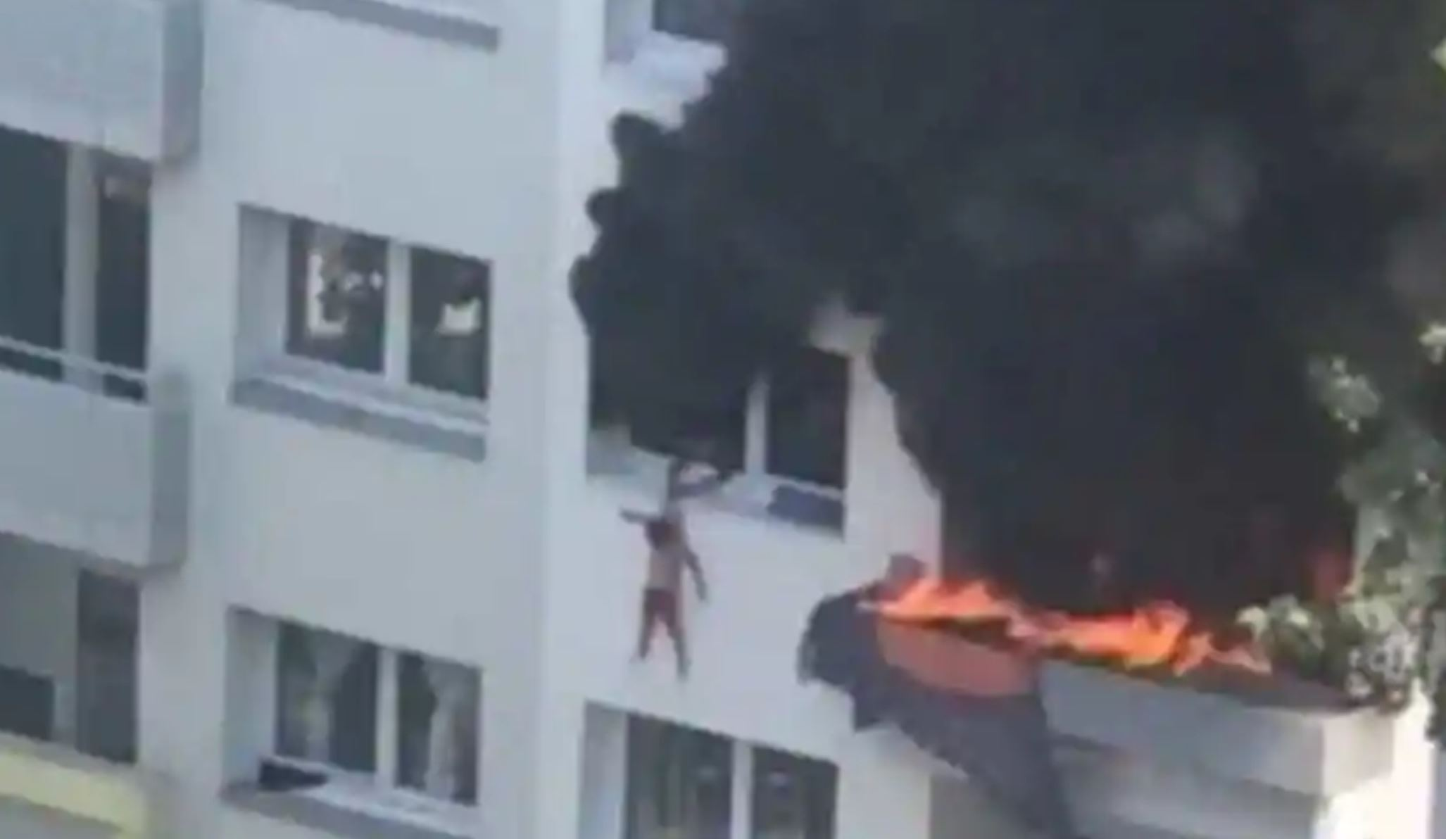 WATCH: Children miraculously saved by crowd after jumping from burning building in France