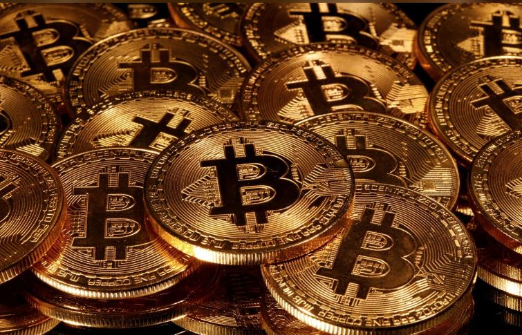 Bitcoin rises above $10,000 for first time since early June