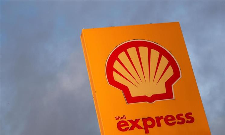 Shell avoids loss with strong trading, wipes $17 billion off assets