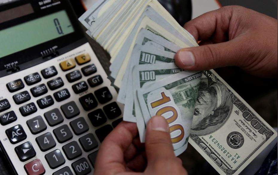 Dollar wallows and stocks inch higher as stimulus eyed
