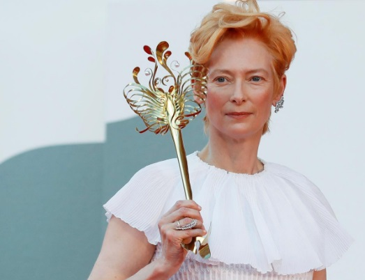 Venice film festival opens with show of support for battered industry