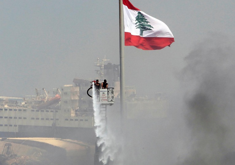 Smoke from Beirut port remnants of Thursday fire, 'no danger to city'