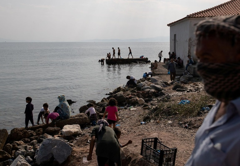 Migrants stranded by Lesbos fire resist new temporary camp