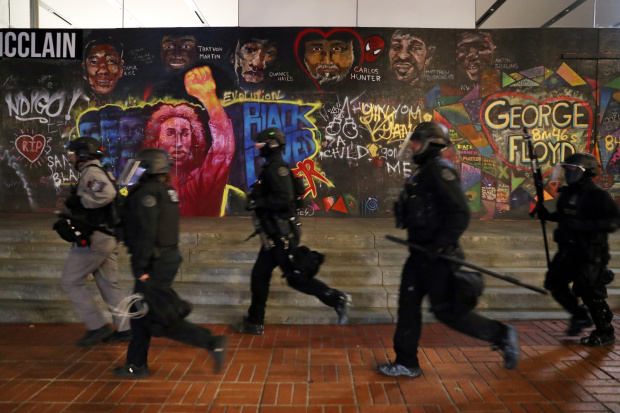 Police clash with Portland protesters and press; more than 12 arrested