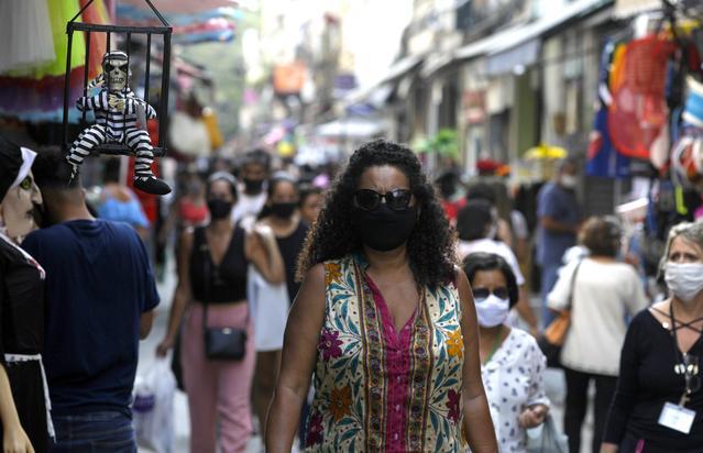 Brazil reports 14,318 new cases of coronavirus, 335 deaths