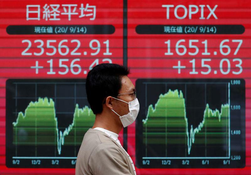 Asian shares buoyed by China optimism, markets eye US presidential debate