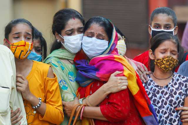Virus sows dread in India's festival season as infections cross 6 million
