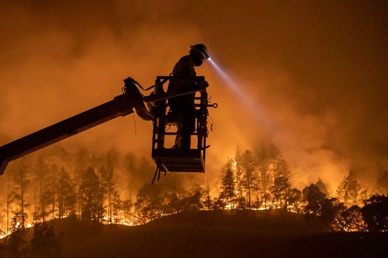 Northern California wildfire death toll rises to four as crews scramble to beat winds