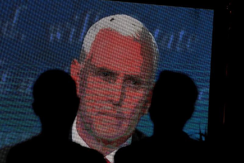 Buzz off! Errant housefly on Pence's head photobombs VP debate