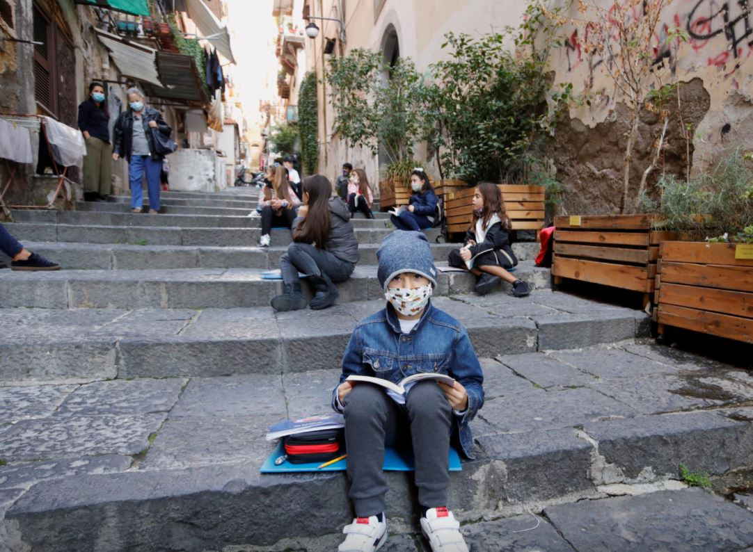 Naples teachers bring socially-distanced school to streets and balconies