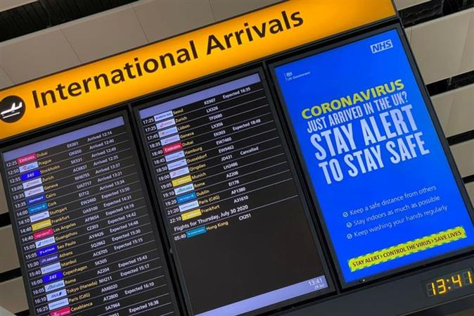 Britain sets mandatory Covid test for travelers